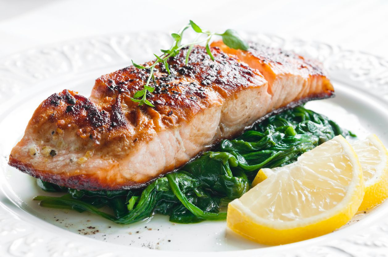 A baked salmon recipe that is gently infused with cannabutter and garlic