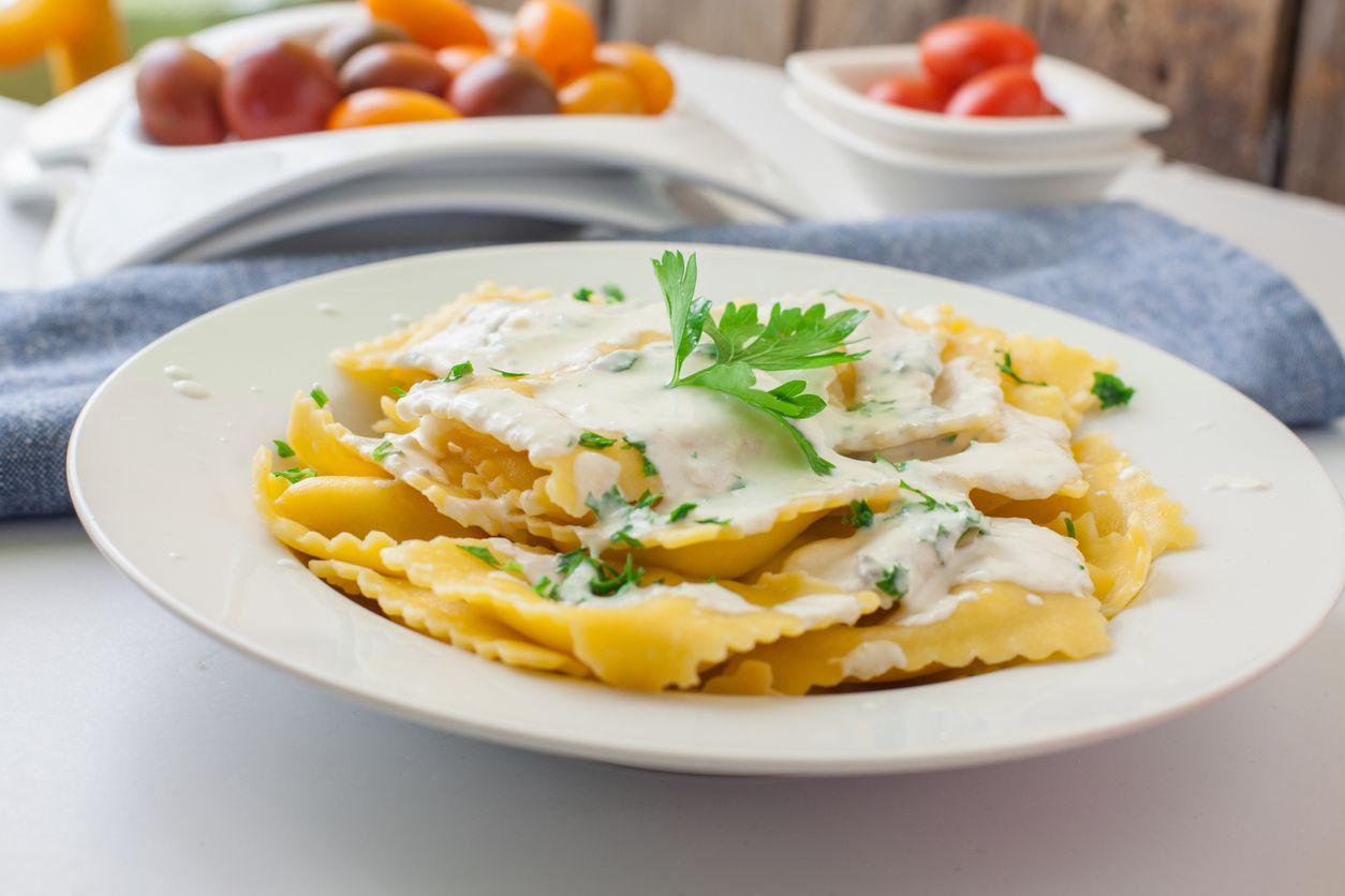 Homemade ravioli with four cheese sauce