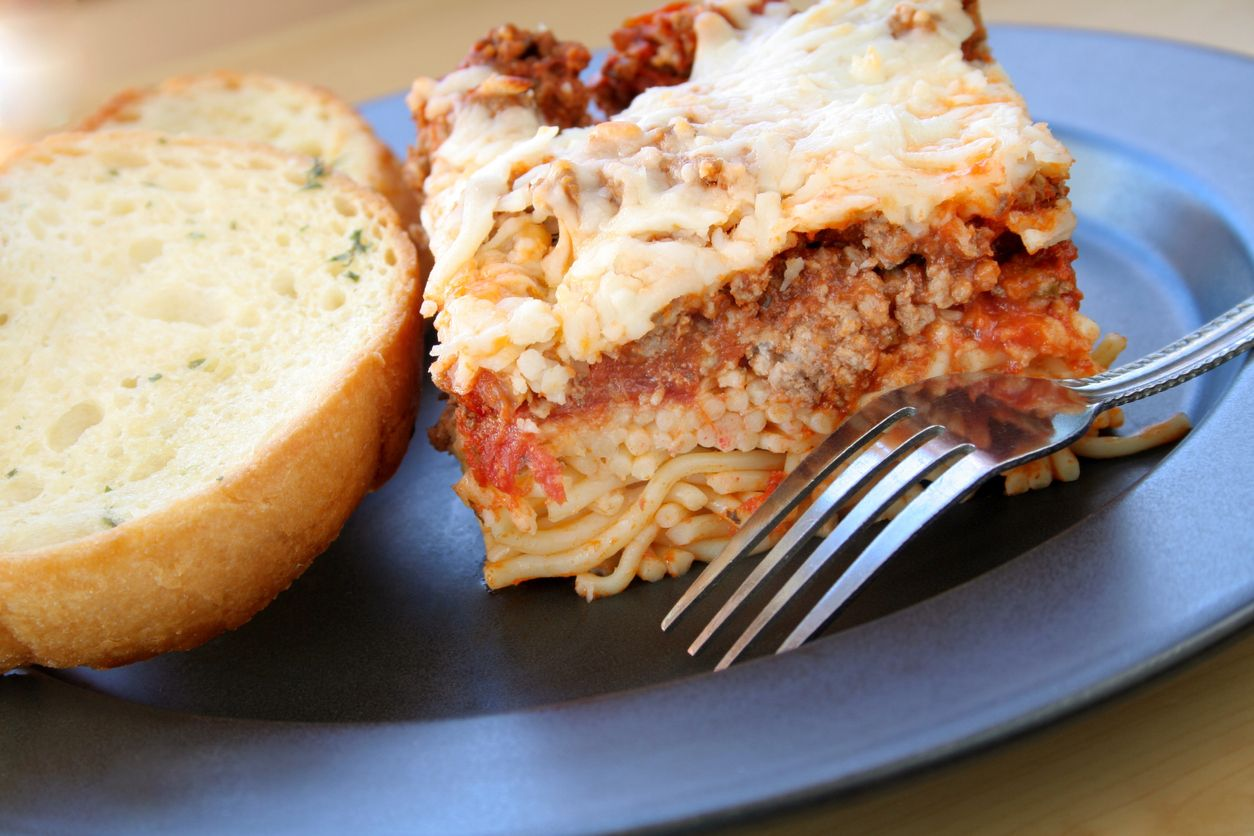 Ovenbaked spaghetti casserole with cheese and weed